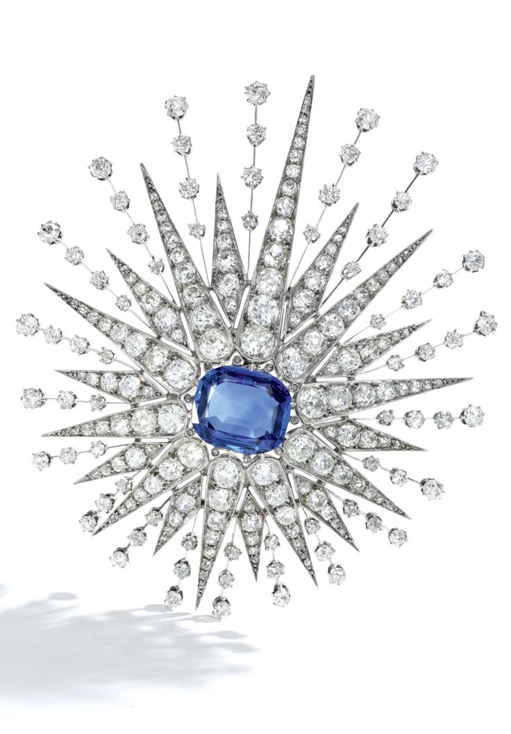 An antique sapphire and diamond brooch, late 19th century. Designed as a sunburst mounted en tremblant, set with a cushion-shaped sapphire weighing 12.96 carats and cushion-shaped, circular-cut and rose diamonds, brooch fitting detachable. #antique
