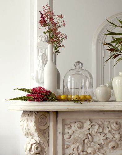 Ornate marble mantelpiece as a room focal point. Photography by Seth Smoot.