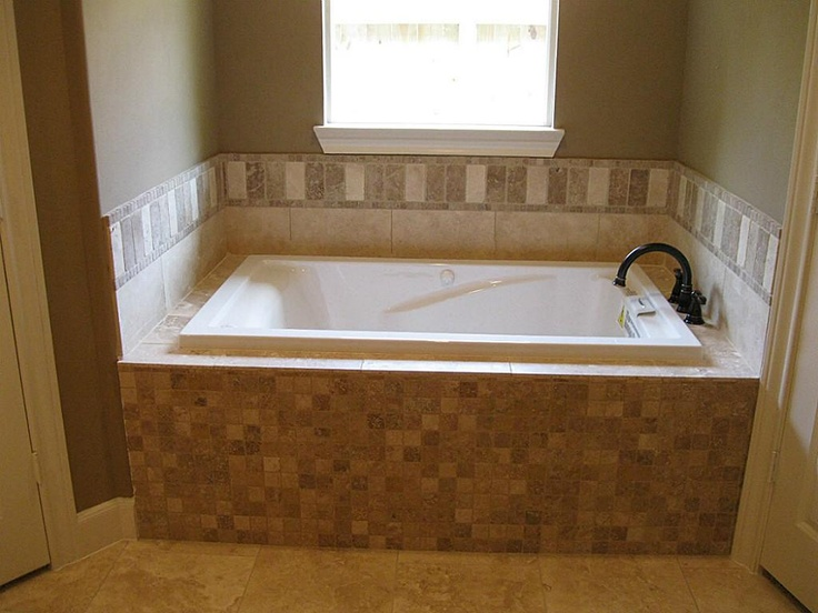Whirlpool Tub With Custom Travertine Tile Work And Oil Brushed Bronze Fixtures Decorating