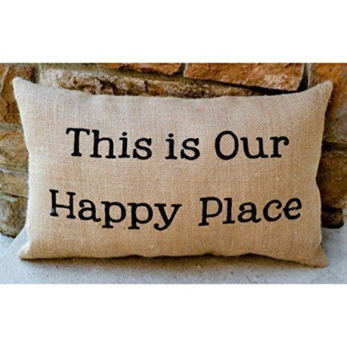 Get the Burlap Lake Home or Cabin Rustic Throw Pillow, which is a burlap brown pillow that says 'This is our happy place' on it and would go well in a cottage home.