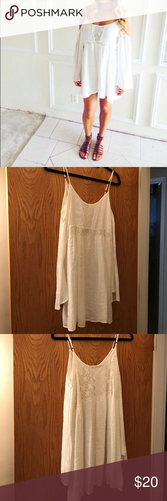 White festival mini dress - never worn Honey punch brand white linen festival dress. Open shoulder with flowy sleeves. Lace pattern on chest and waist - adorable with gladiator or strappy sandals and big jewelry! Honey Punch Dresses Mini