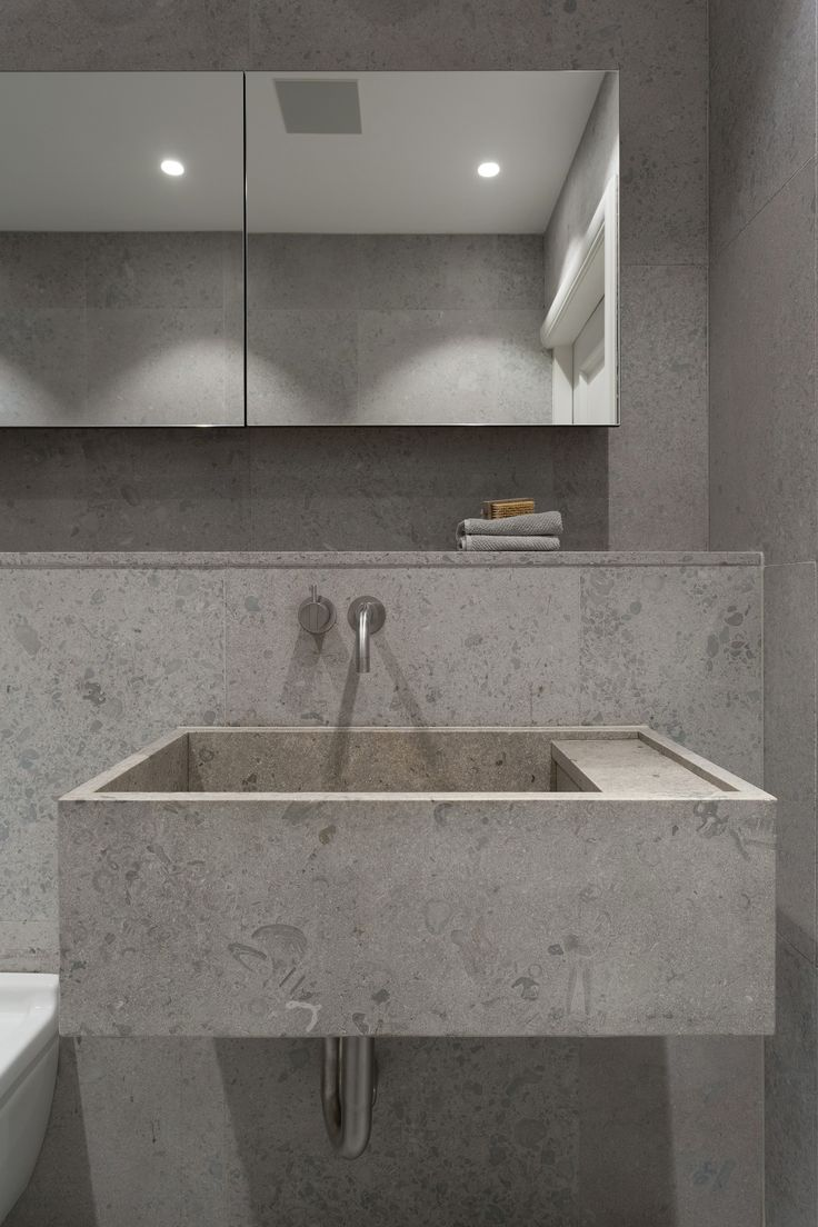 Grey bathrooms designline bathrooms3 - Gold Gray Apartment Is A Minimalist Residence Located In Stockholm Sweden Designed By Richard Lindvall