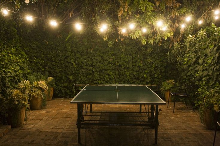 ping pong at chateau marmont.Games, Tables Tennis, Outdoor Living Spaces, Pools Tables, String Lights, Pingpong, Gardens, Ping Pong Tables, Backyards Spaces