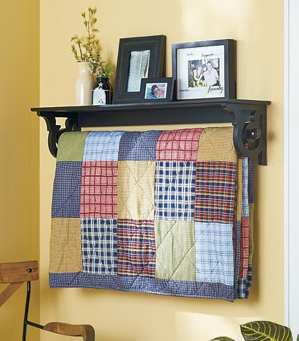 This wall mounted Quilt Rack with Shelf helps organize an entryway with simple style. It's pretty scrolled sides complement the dowel's knob finials. Display a