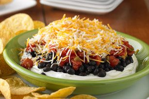 Layered Black Bean Dip.  Easy, quick, and very good.  Use whipped cream cheese for easy dipping, add chopped garlic, & Use flavored diced tomatos (drained). Can also mix a packet of taco seasoning in the cream cheese.