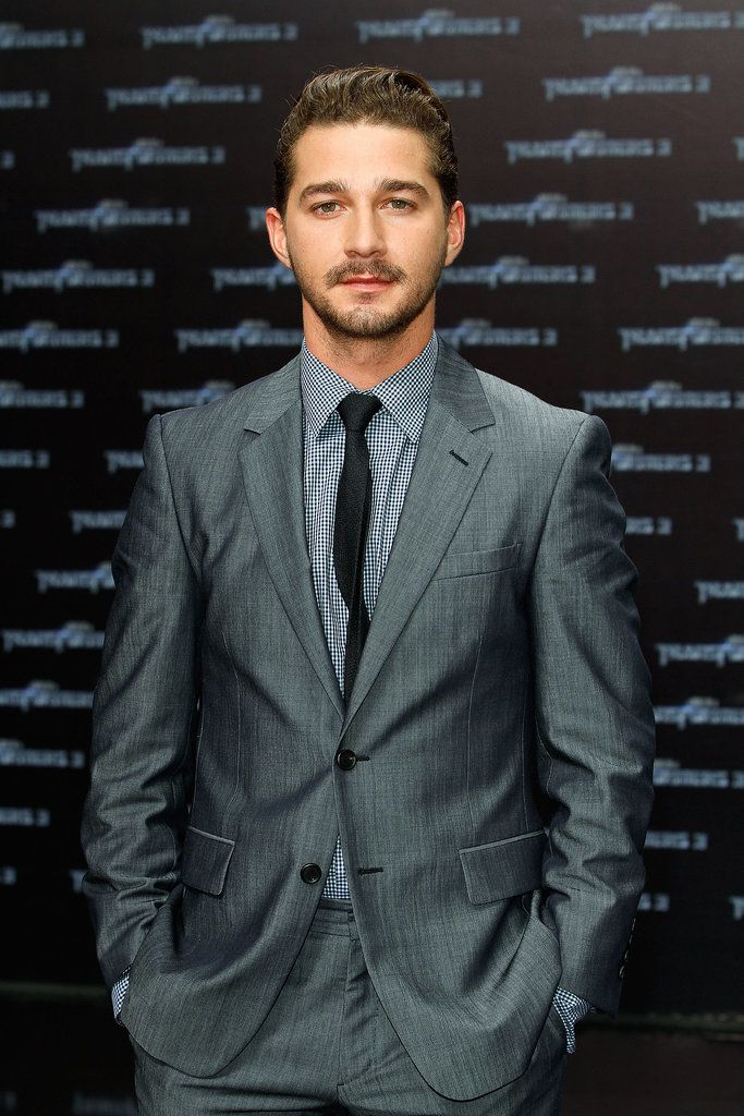 Between the gray suit, the skinny black tie, and the perfectly manicured facial hair, Shia was the picture of hotness at the June 2011 premiere of Transformers: Dark of the Moon in Germany.