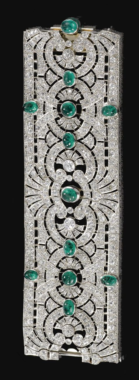 EMERALD AND DIAMOND BRACELET, CIRCA 1925.  Designed as a wide open work band of palmette and scroll design, collet-set at intervals with cabochon emeralds, millegrain-set with circular- and single-cut diamonds, mounted in platinum,  French assay marks, case by Henri Lyon et ses fils, 12, Rue de la Paix, Paris.  length approximately 184mm