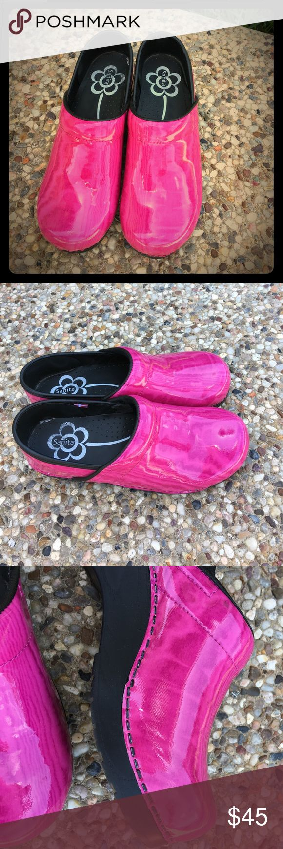 Hot Pink Sanita Clogs Size 38/7.5-8 These Clogs are in great condition. The only flaw is a small chip mark as pictured in pic 3. No noticeable when wearing. They have a shiny finish. Only worn a few times on carpet. So comfy! Inside is spotless.. No box Sanita Shoes Mules & Clogs