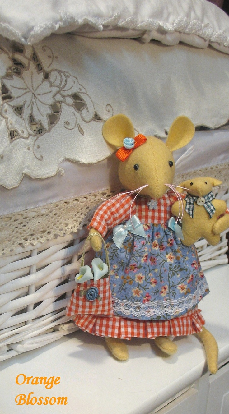 ORANGE BLOSSOM A darling little mouse...Very sweet indeed....Gorgeous as well. $42.00, via Etsy.