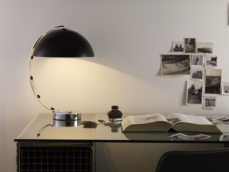 With the right lighting you can create an effective workspace in your home. Featuring Original BTC's London Table Light. #lighting #lightingdesign