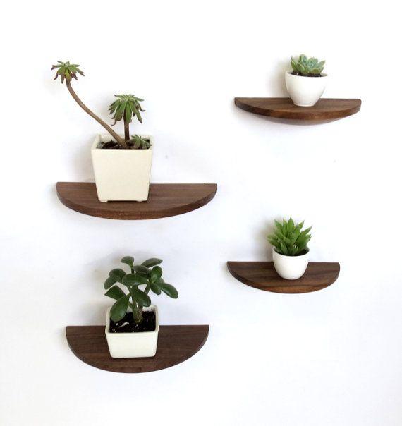 Set of four half round walnut shelves