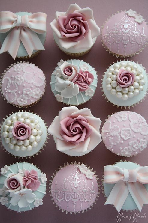 Hand-crafted floral and pearl details in dusty pink and blue hues give these cupcakes a refined and feminine feel.