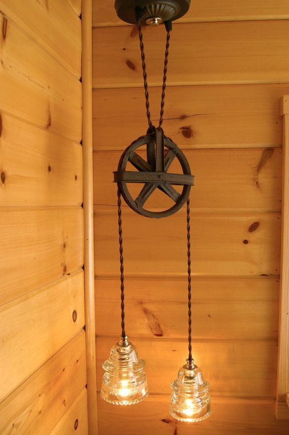 Oh my! I have to figure out a way to do this!  I LOVE it!   Industrial Chic Vintage Pulley & Insulator Hanging Light