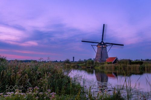 Windmill by hharacic  sky sunset water reflection travel twilight architecture netherlands windmill canal rotterdam the ne