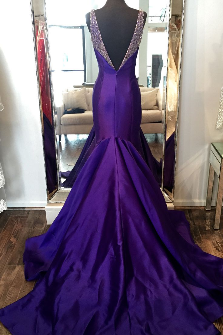 Fit and flare evening gown with a gorgeous long train. Hand beaded straps on…