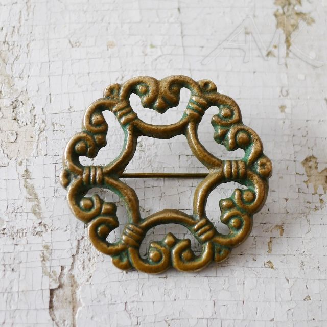 Suotniemen solki, pronssi. Old Kalevala Koru bronze brooch.
