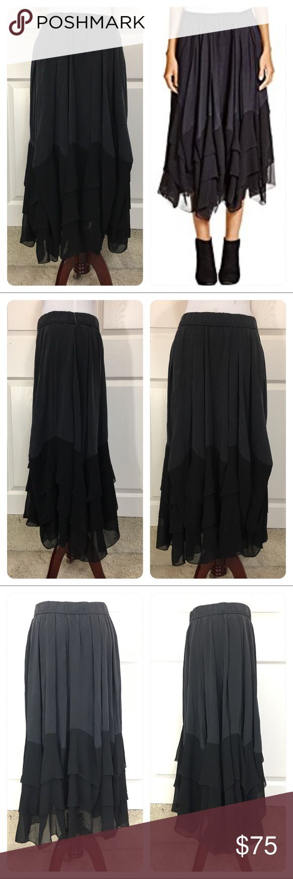 DKNY PURE  Silk Blend Pleated Tiered Skirt New with tags from a secondary market store. DKNY Pure Silk Blend Pleated Tiered Skirt. Elastic waist. Amazing addition to your wardrobe. No flaws noted. Dkny Skirts