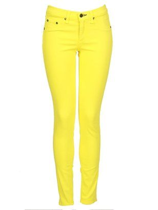 neon yellow pants   She anchored the look with a cream sweater and Louboutin peep toe ...