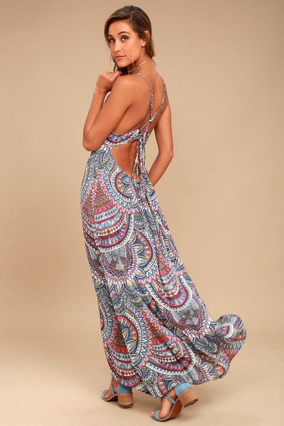 You'll be in a hurry to show off the Billabong Places to Be Blue Print Maxi Dress! Eye-catching blue, pink, white, and yellow print decorates this breezy, woven maxi dress with a backless, triangle bodice and adjustable straps that tie at back. Empire waist (with a bit of elastic at back) falls to a flowing maxi skirt. Metal logo tag at back.