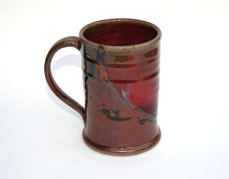 Chez Red / temoky: Mug-Glossy copper red glaze. Deep tones spanning from copper/rust to venetian reds.  Partnered with a matt brown, with lines of black where the glaze breaks on the edges.