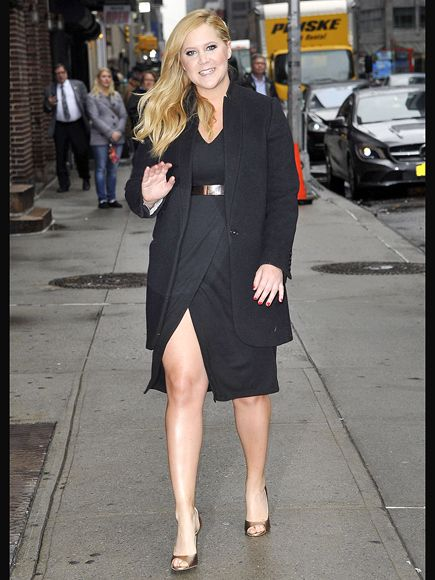 Star Tracks: Tuesday, April 21, 2015 | FUNNY GIRL | Comedian Amy Schumer is sleek and svelte in a black dress and metallic heels on the way into the Late Show with David Letterman in N.Y.C. on Monday.