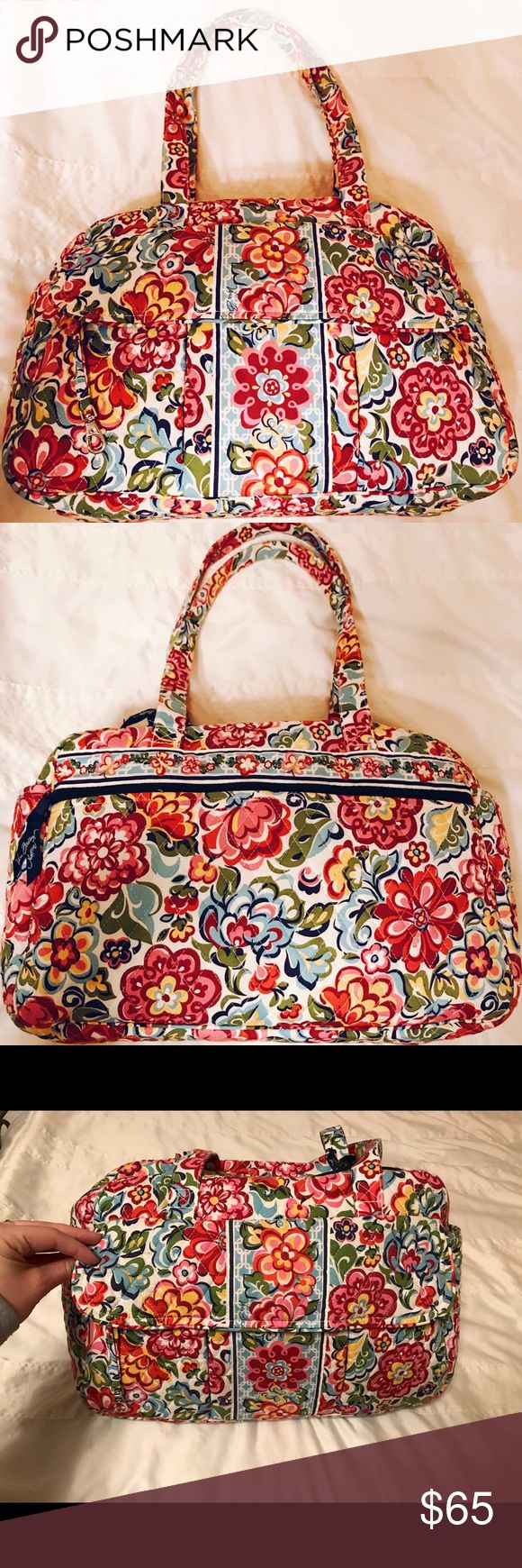 Vera Bradley Duffel Bag Floral Vera Bradley Duffel Bag. Inside of the bag contains 5 different compartments. The outside of the bag has two side pockets, a large zipper compartment and three separate compartments on the opposite side of the bag. The bag is in great condition and shows no signs of wear. Please feel free comment with questions! I will ship out same day of purchase 😀 Vera Bradley Bags Travel Bags