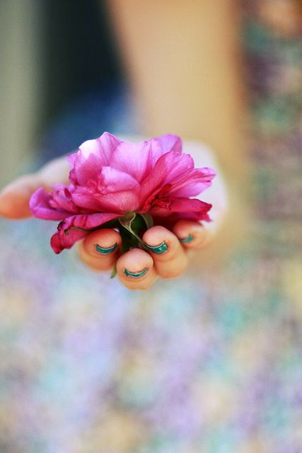 pink flower, blue nail polish