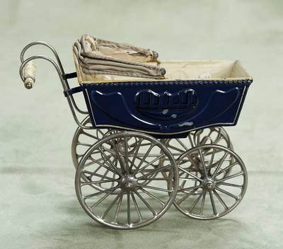 Miniature German painted tin carriage with sunshade attributed to Maerklin