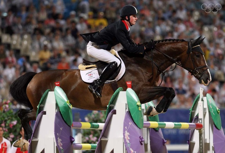 HONG KONG, CHINA - AUGUST 21: Ben Maher of Great Britain and Rolette jump a fence during the Individual Jumping Final - Round B held at the Hong Kong Olympic Equestrian Venue in Sha Tin during day 13 of the Beijing 2008 Olympic Games on August 21, 2008 in Hong Kong, China.  (Photo by Julian Herbert/Getty Images)