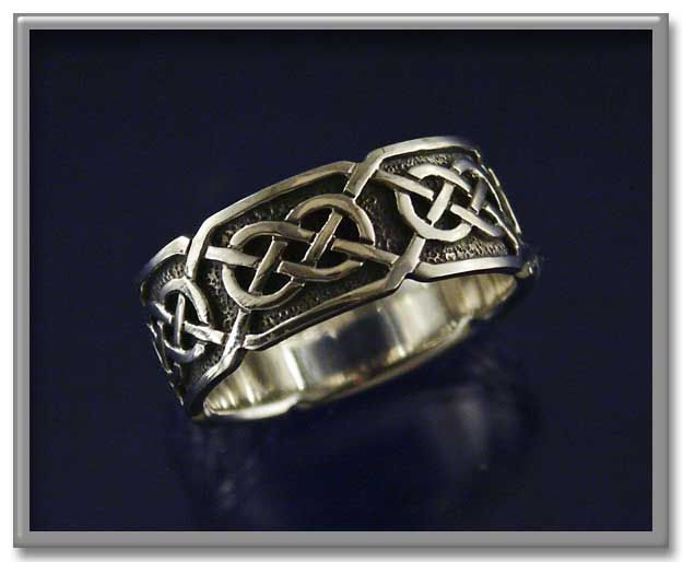 """""""Síorghrá"""" Celtic Ring - """"Síorghrá"""" can be translated from the Irish Gaelic as """"Eternal Love"""". At approximately 3/8"""" wide, this ring is beautifully suited for both male and female hands. Made of sterling silver. <BR><BR><span class=""""clearance"""">New Lower Price!</span>"""