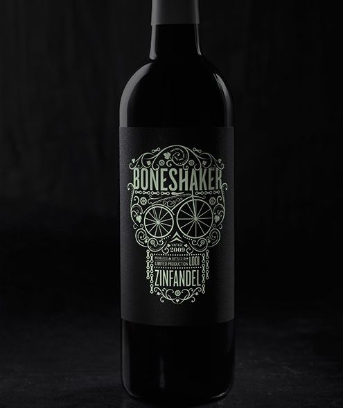 This is an awesome bottle design. I love how the text was incorporated into the artwork of the skull. Very nice use of contrast on the black background