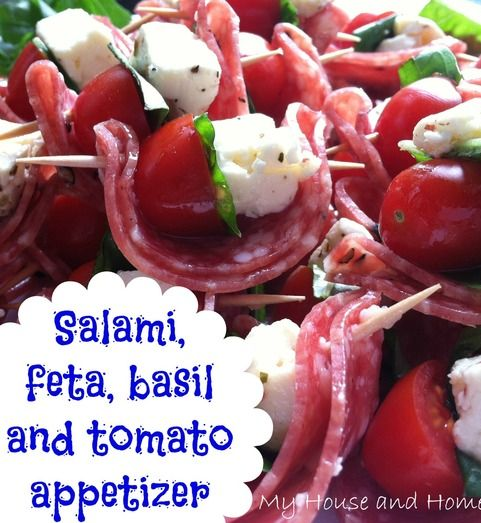 Salami, feta, basil, and tomato appetizer. Mozzarella would be good in these!