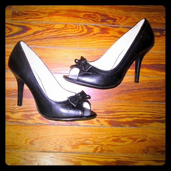 Black pumps SALE‼️‼️ ONE DAY SALE.  Shipping deal Black peep toe pumps, now detail in the front of the shoe, minor stains inside of the shoes, good condition, gently worn Shoes Heels