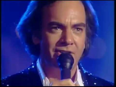 It's difficult to choose just one Neil Diamond song, but this is a great one -- and besides, he's wearing a sparkly jacket!