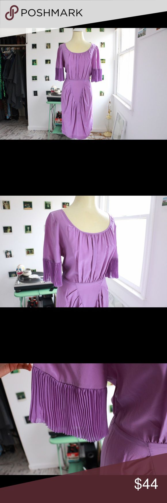 BCBG MAX AZRIA Purple Dress Bio: This interesting piece features sheer pleated detailing at sleeves, a portrait neckline and folding at hips. Details: Hip to waist zip and snap closure at back, pleated sleeves. Bust: 36 inches Waist: 28 inches Hips: 36 inches Full Garment Length: 38 inches BCBGMaxAzria Dresses Midi