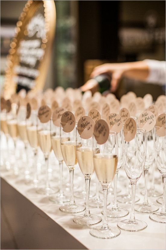 champagne escort cards with gold tags.  What a fantastic idea!