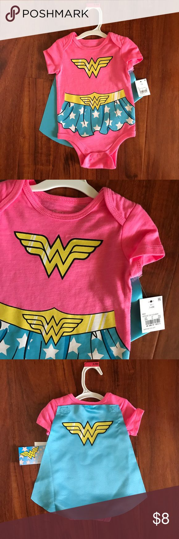 NWT Wonder Woman Cape Onesie Brand new with tags baby girl pink and blue Wonder Woman onesie with matching cape. Size 3-6 months. One Pieces Bodysuits