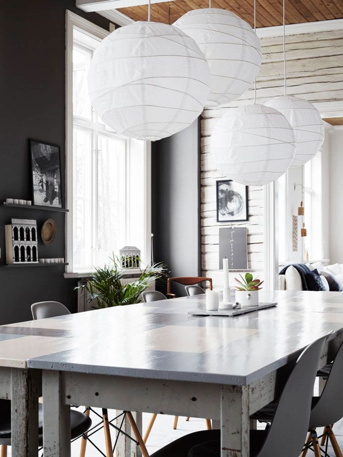 There's an ethereal feel to these giant paper lanterns, a sideways take on a traditional chandelier. In calligrapher Ylva Skarp's home, as seen at Nordic Design, four huge lanterns hang over her kitchen table, creating a whimsical effect.   - ELLEDecor.com