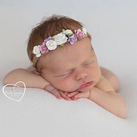 Fermatenda fiore archetto corona neonato foto di masonandharlow