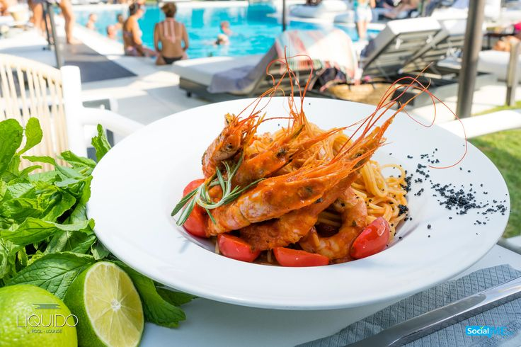 Fresh lime, a dash of pepper, and baby tomatoes accompany Liquido's signature shrimp dish. Delight in yours next time you have lunch at our pool lounge.