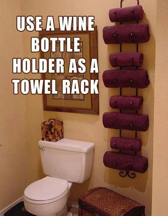 Use a wine rack for towels!  Great idea!