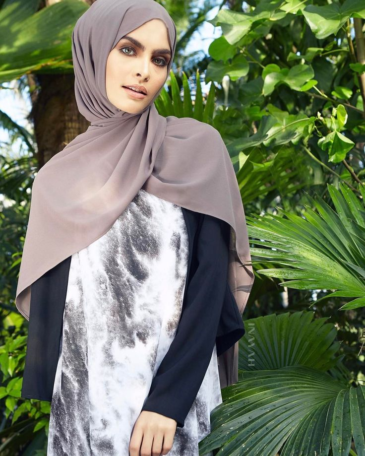 INAYAH | A slip dress designed in dark and light tones, which can be worn underneath our Outerwear as well as Kimonos and Open Abayas. Elevate your ensemble with a modest, stylish layered edge.   Marble Print Slip Dress  Black Classic Cropped Jacket  Ash Soft Crepe Hijab   www.inayah.co