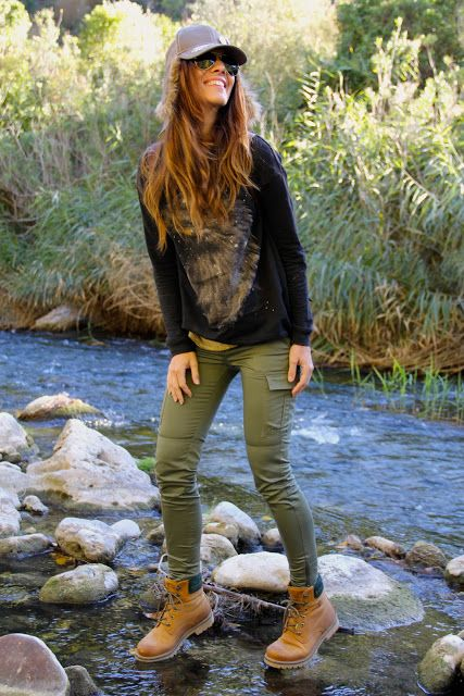 military green skinny pants, black graphic sweater, grey baseball hat, brown combat boots