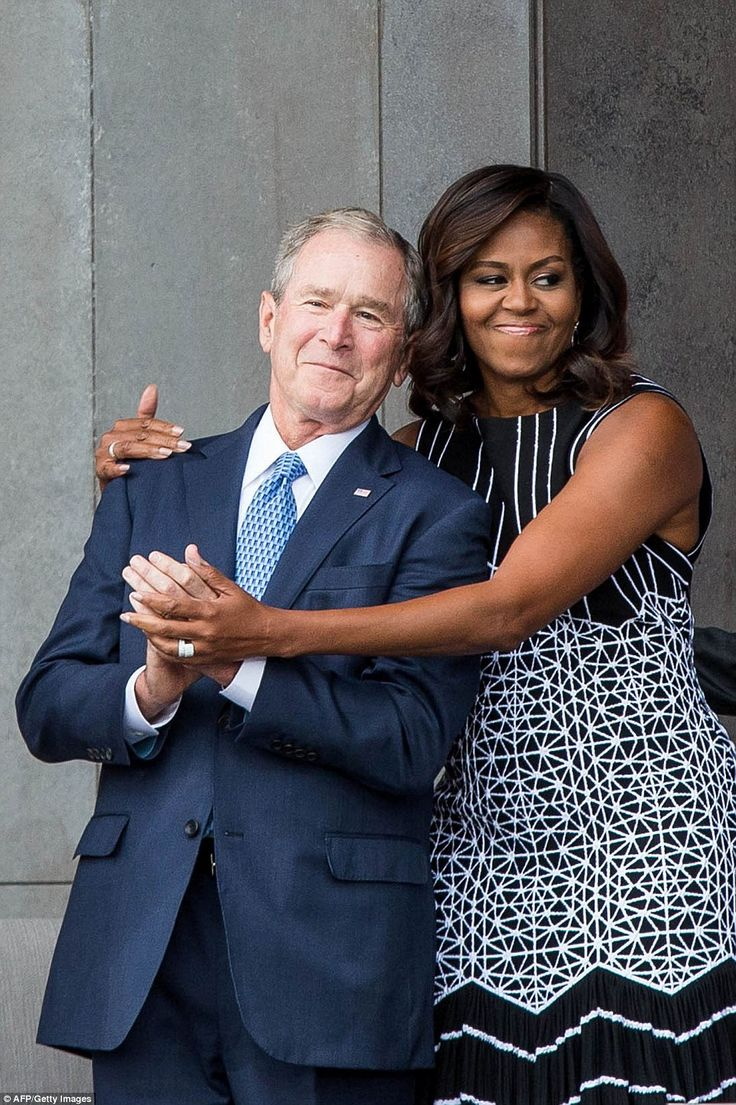 First Lady Michelle Obama and Former President George W Bush shared a sweet embrace at the opening of the Smithsonian National Museum of African American History and Culture on Saturday