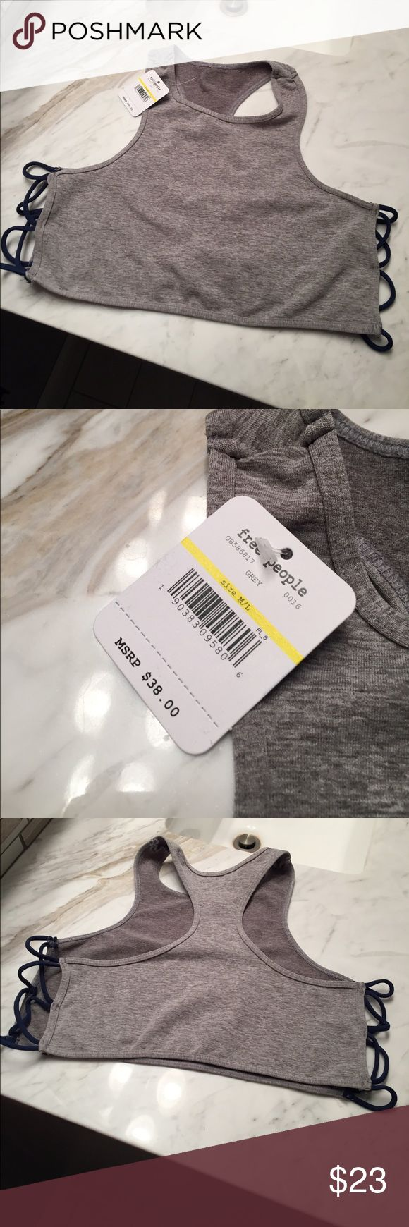 • NWT: free people sports bra • Gray and navy blue sports bra. Brand is free people. NWT never worn. Size M/L. Super cute. Same or next day shipping, smoke free home. For my reference only: item #63 Free People Intimates & Sleepwear Bras