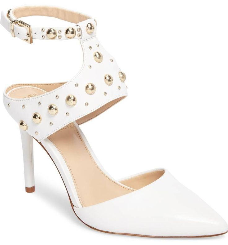 Polished dome studs punctuate the edgy, cutout straps of an eye-catching pointy-toe pump.