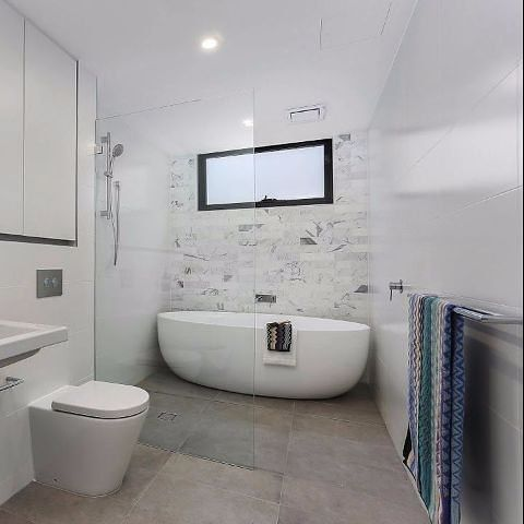 Stunning bathroom with marble and free standing bath. The perfect place to be found relaxing after a big week. Design by Pinnacle Plus.