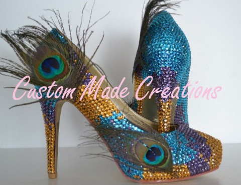 These stunning handmade shoes have over 4000 individually placed crystal applied    with procession taking over 12 hours to complete one pair.      'Dare' is pictured with a 5 inch heel in the pump shoe style.    The crystal colours used are numbers 19, 27 & 28 with the peacock feather embellishment.    Want your very own custom pair created just for you?    Contact us with your special requirements & we will do our best to accommodate your needs.    OUR SHOES ARE COMPLETELY CUSTOMISABLE