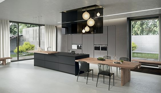 Kitchen island that offers an extended dining table in wood - Decoist