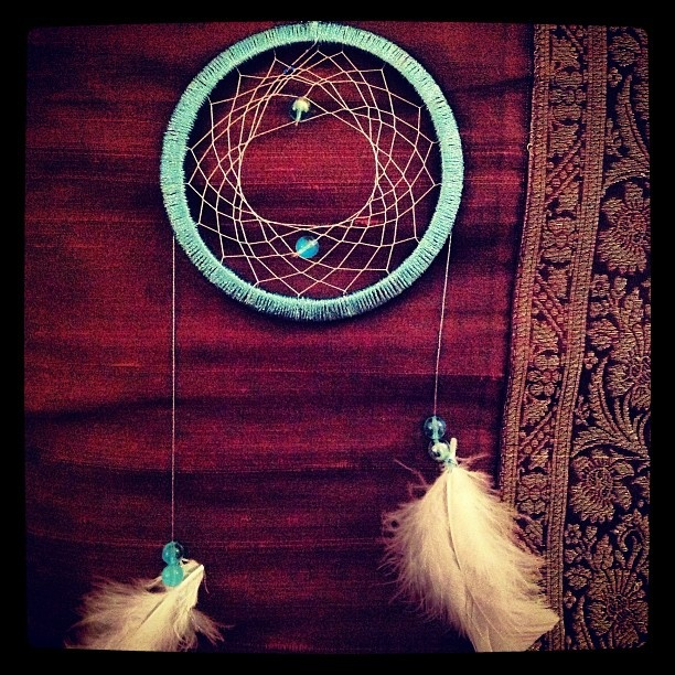 easy dreamcatcher - thread, beads, feathers and a bangle